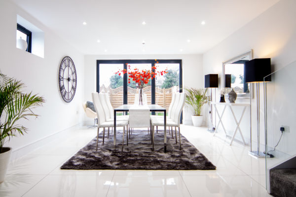 Large dining room with table and chairs on grey rug