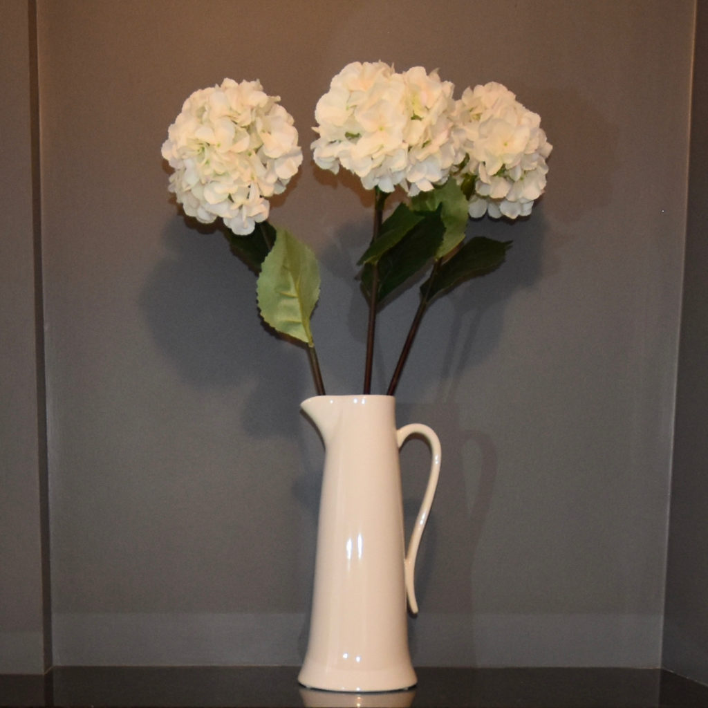 Tall jug and hydrangeas