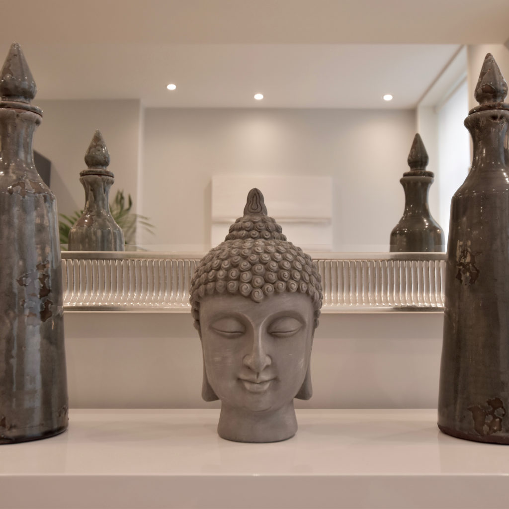 Buddha and tall vases
