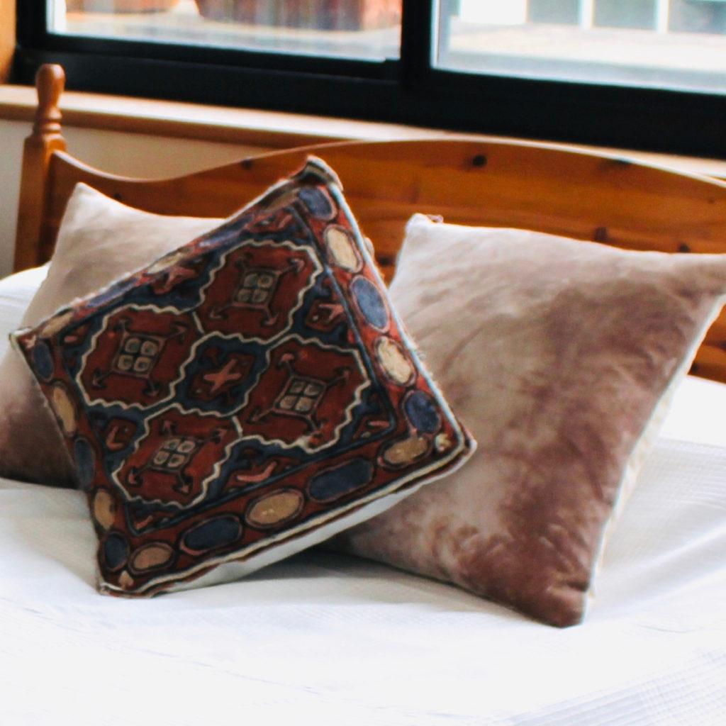 Islington town house cushions on bed