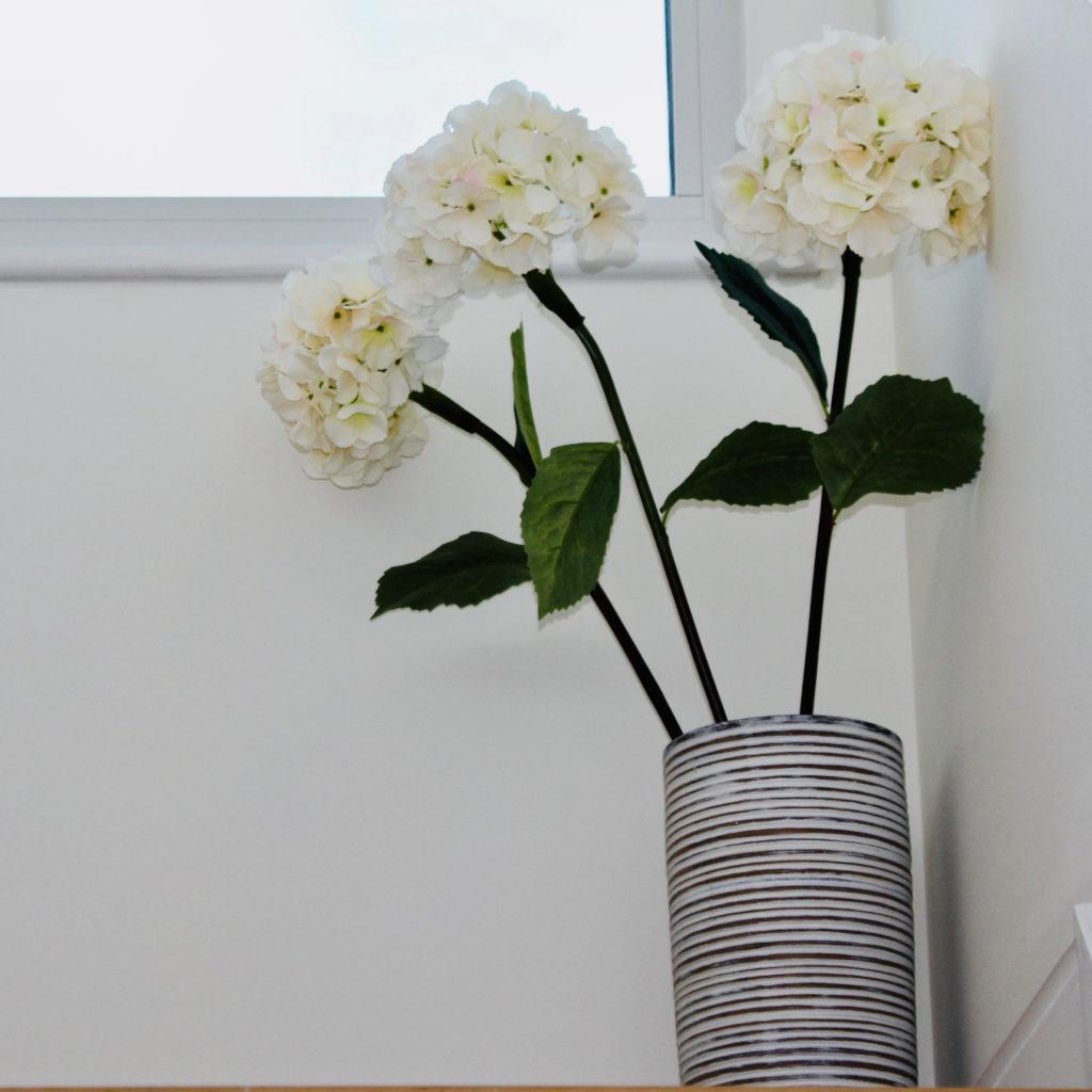 Floor vase and hydrangeas