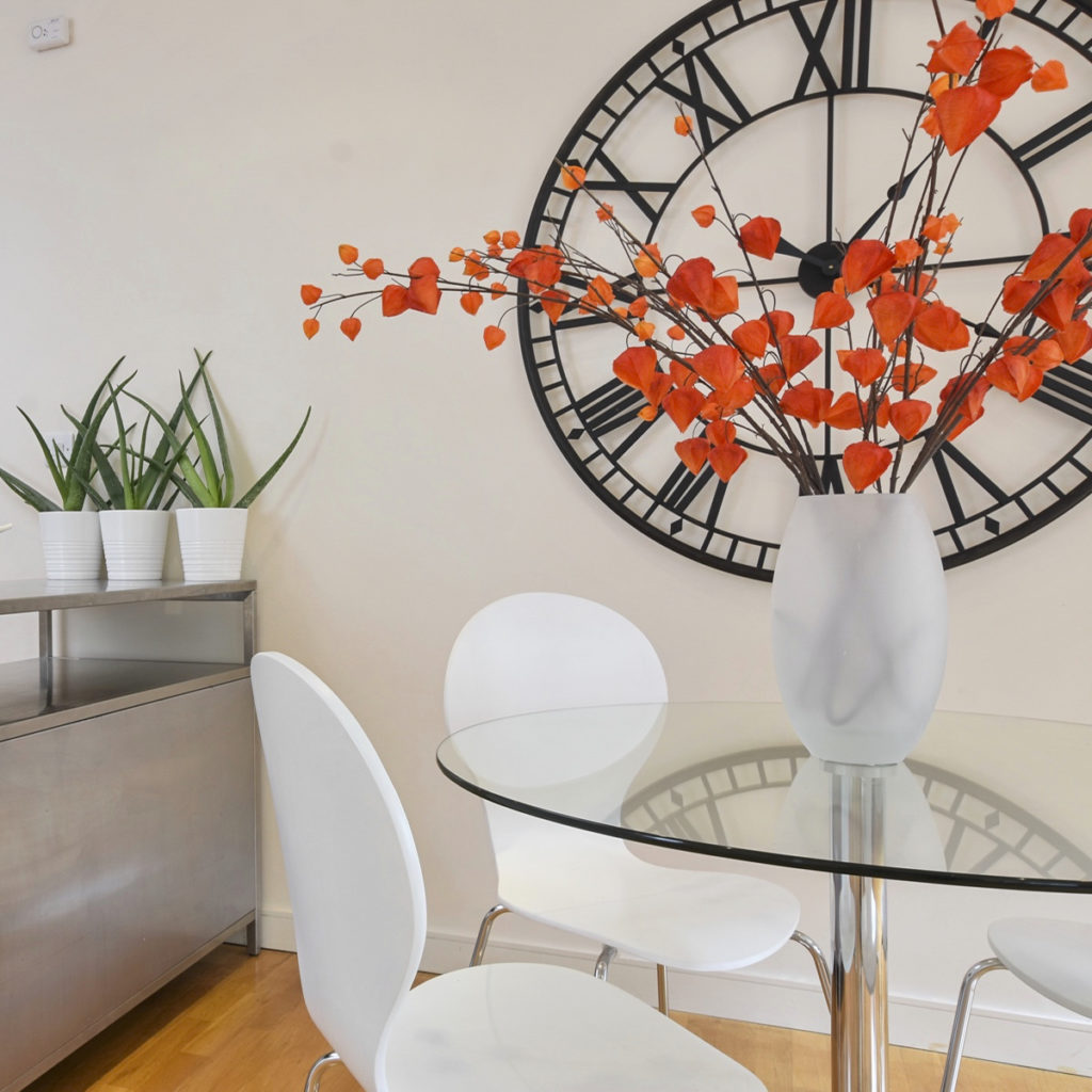 Islington maisonette dining table, Chinese lanterns in vase and clock