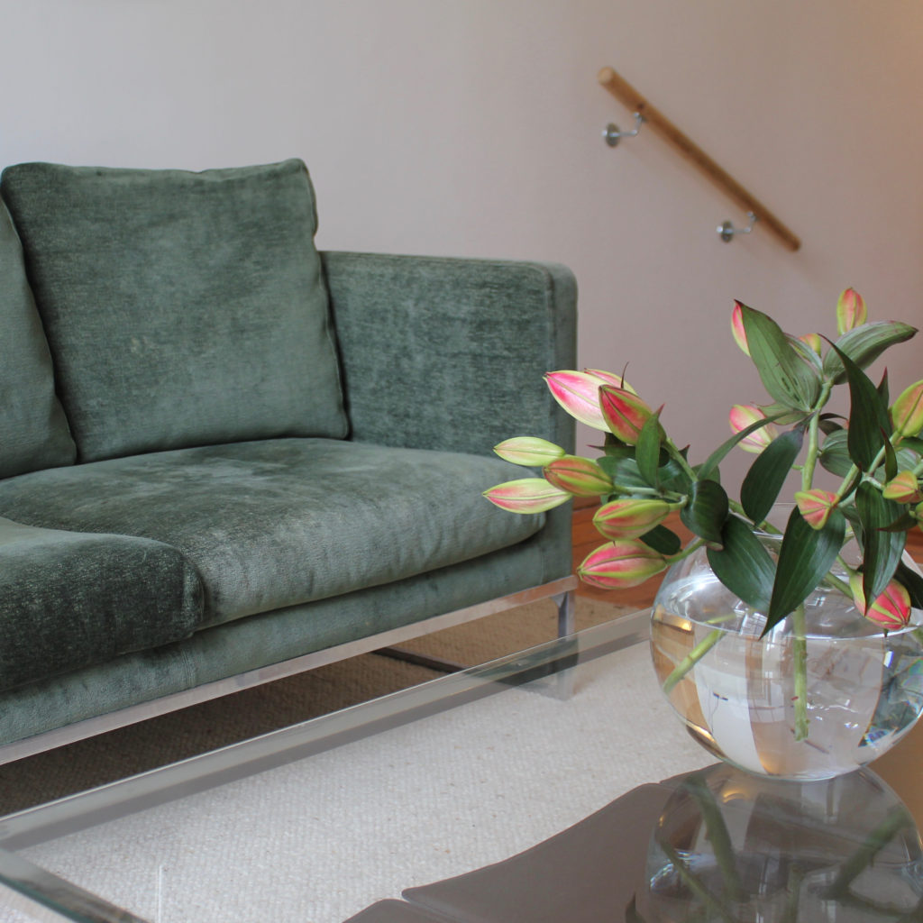 Islington town house flowers in vase and green sofa