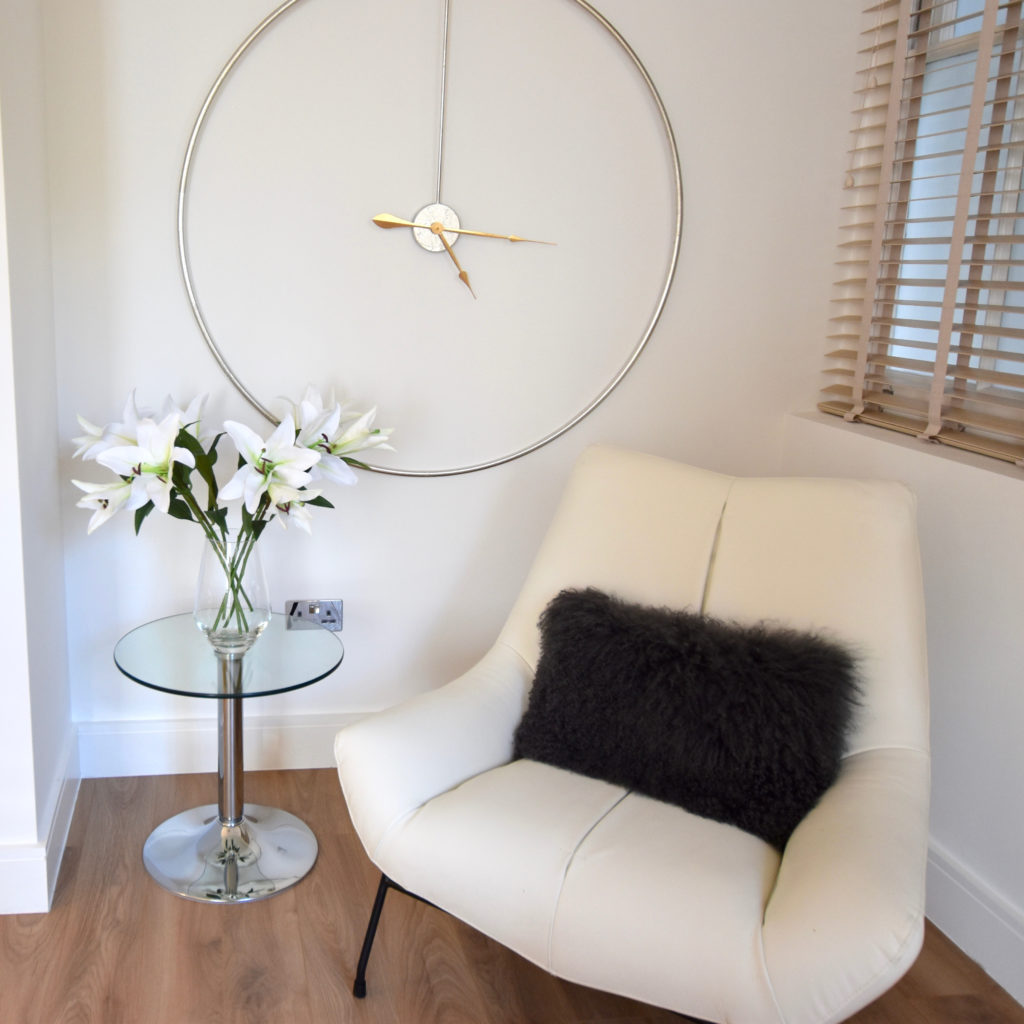 Danetti chair and silver clock
