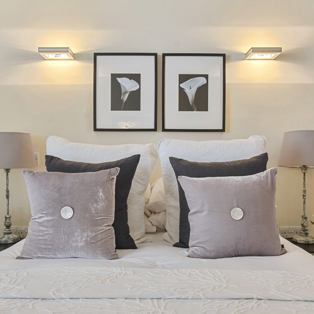 Islington maisonette grey bed cushions and lilly prints