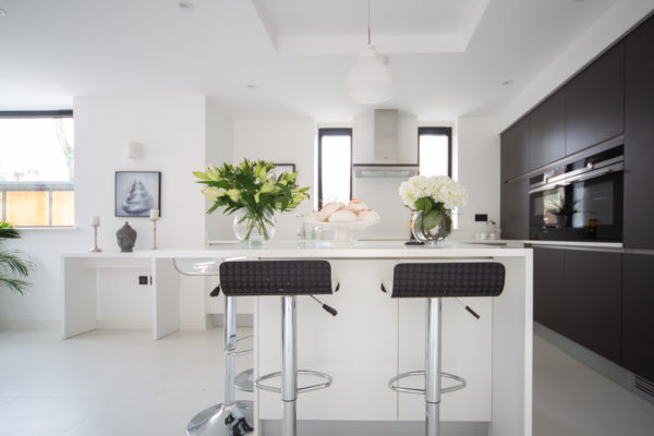 Kitchen with stools and flowers
