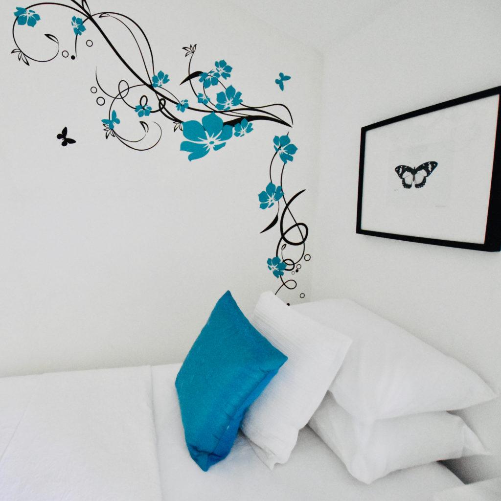 Blue cushion white throw